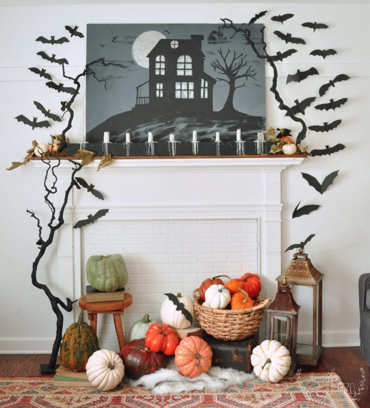 Halloween mantel idea paper bats and pumpkins and haunted house picture