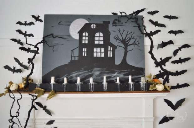 Halloween mantel with drippy candles and paper bats