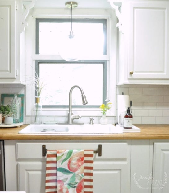 Upclose of kitchen window and Peach towels by Jennifer Rizzo