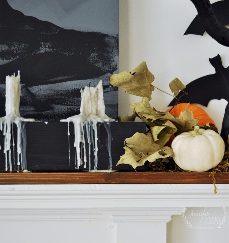 Drippy candle and pumpkin on mantel
