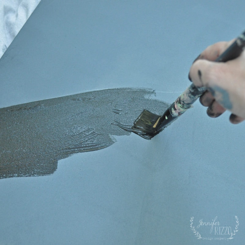 Painting canvas with black paint