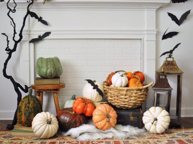 Faux mantel decorating idea with pumpkins, lanterns and bats