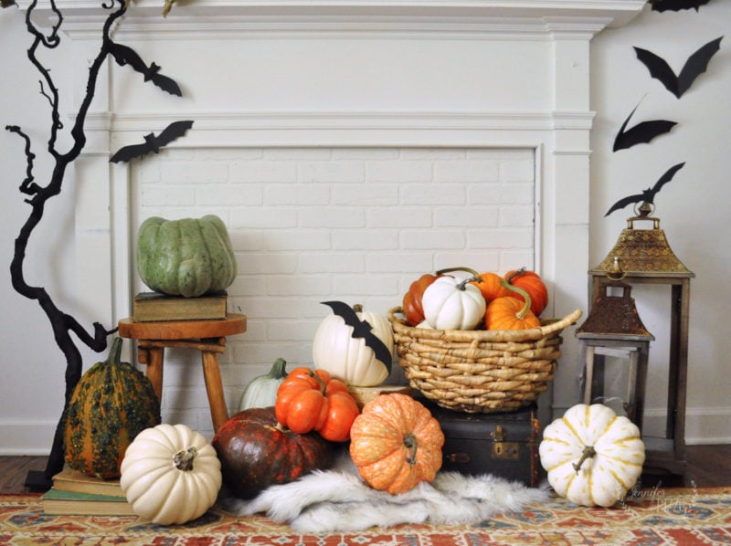 Faux mantel decorating idea with pumpkins, lanterns and bats and stacked pumpkin display