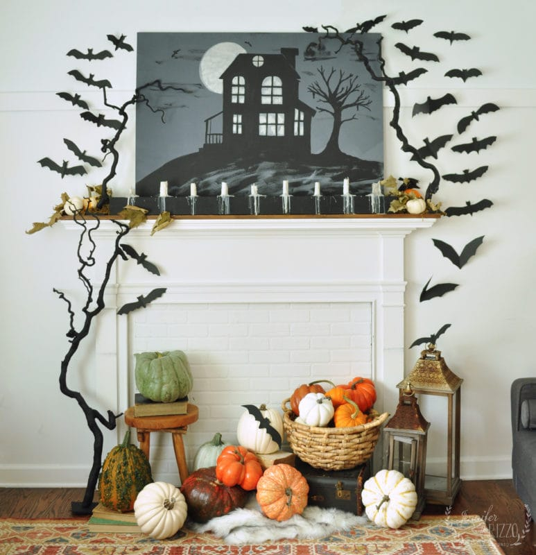 Spooky haunted house fireplace mantel with DIY candelabra
