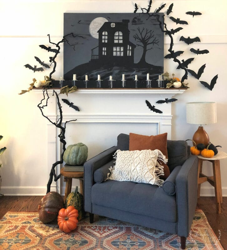 Chair in front of faux fireplace Halloween mantel