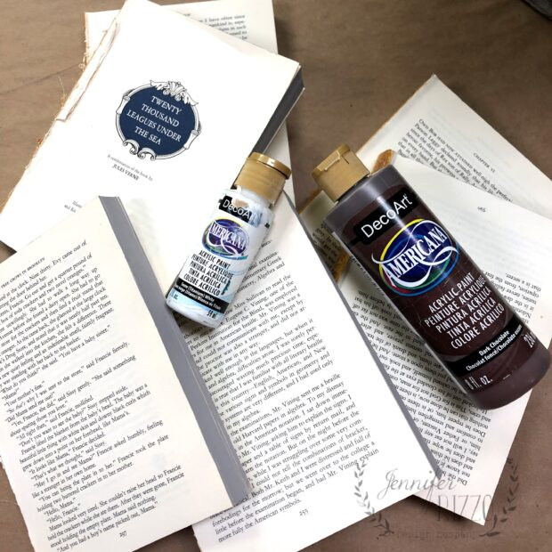 Supplies to create a DIY upcycled stamped book stack