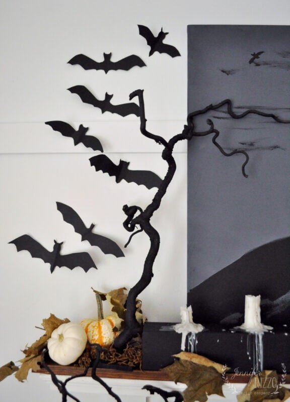 Contorted Filbert branches spray painted and paper bats on a Halloween mantel idea