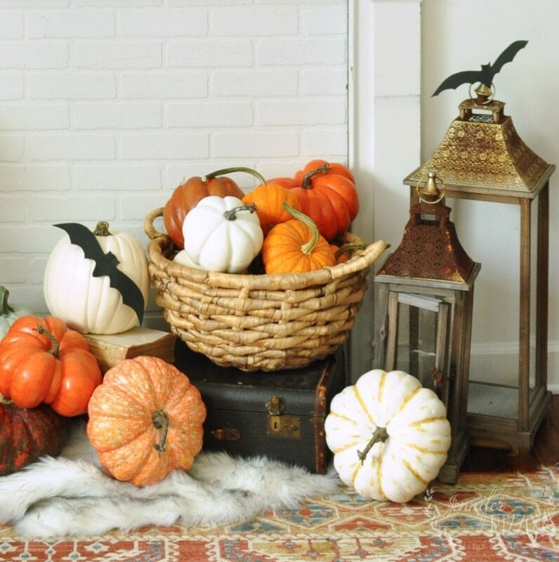 Pumpkins in a basket and lanterns for a faux fireplace decorating idea