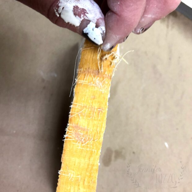 De-spine and remove the cover on old books to make stamped book stacks