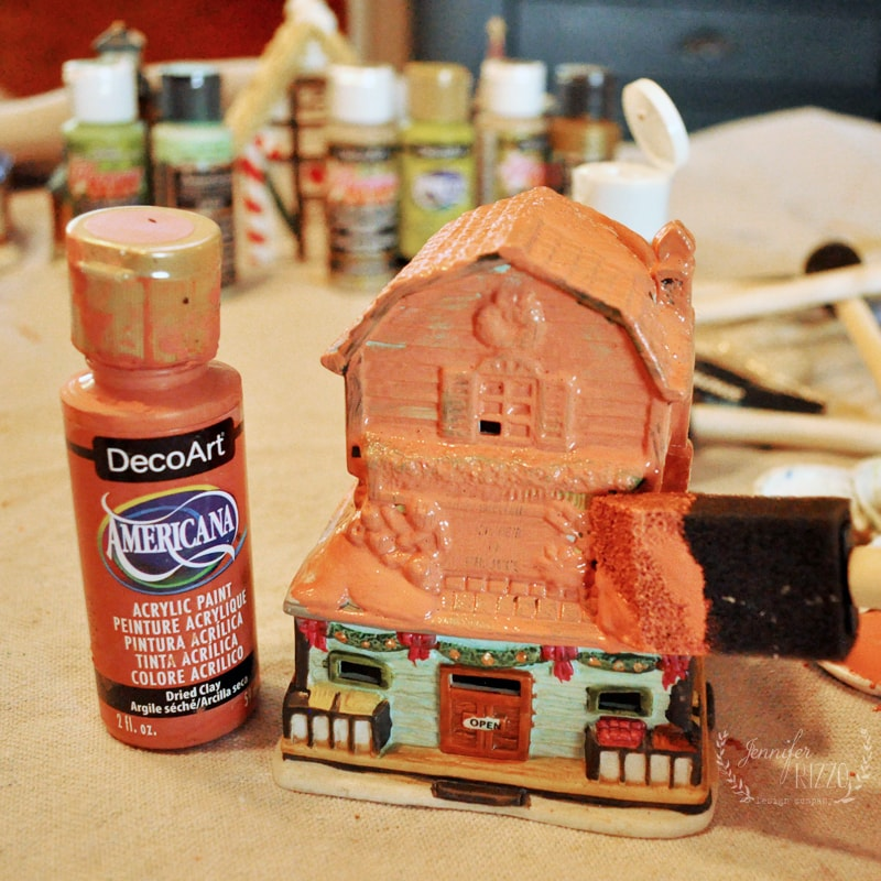 Painting old ceramic thrift store houses for upcycled holiday decor