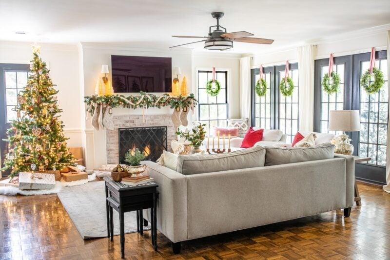 Blesser House Living room with wreaths on windows Jennifer Rizzo Housewalk 2019