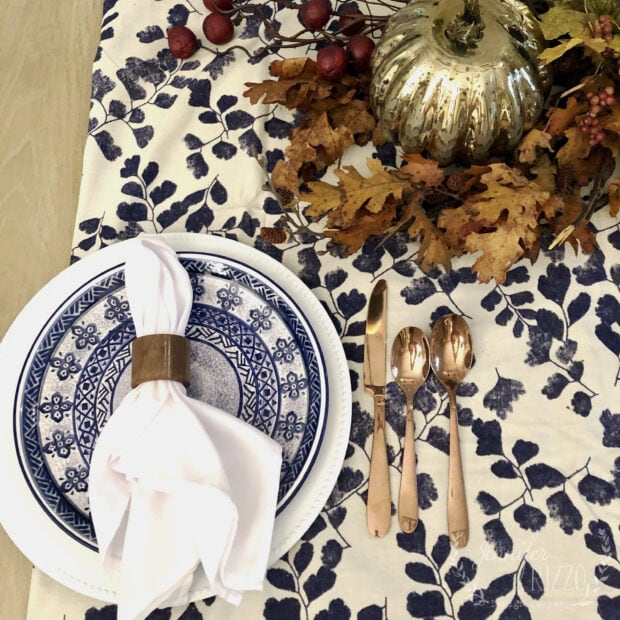Fall tablescape with navy and blue and mercury glass pumpkins