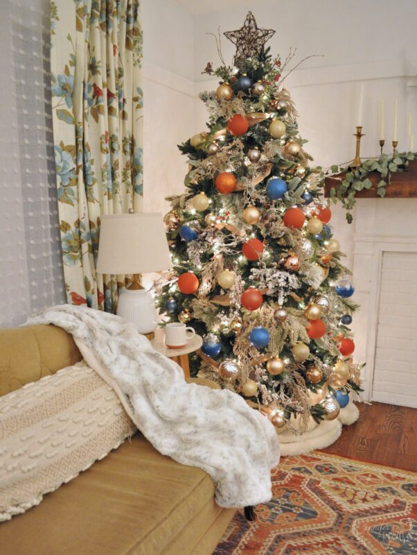 Colorful boho tree in a Christmas Living Room decorating idea