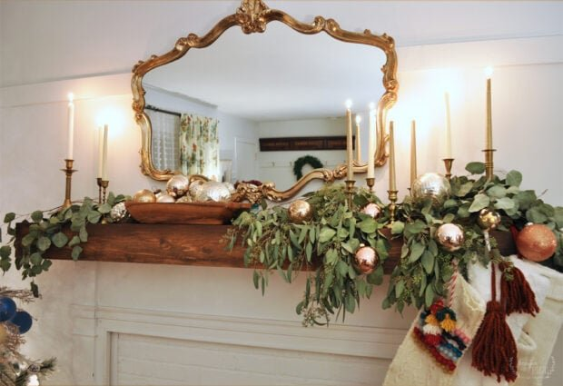Fireplace mantel with ornaments and eucalyptus