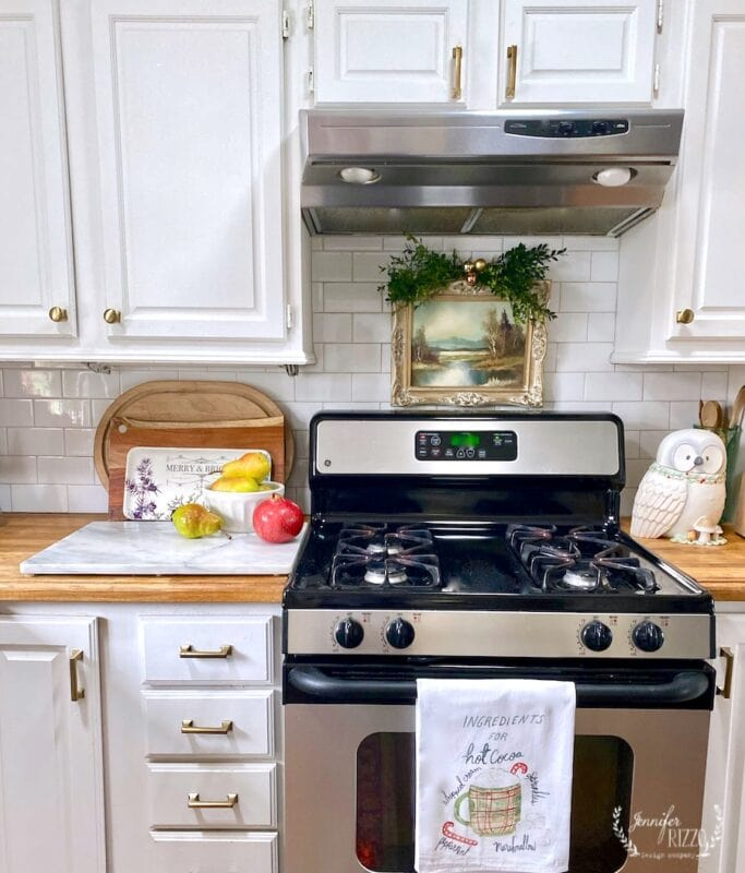 VIntage painting over stove and Hot cocoa towel Jennifer Rizzo
