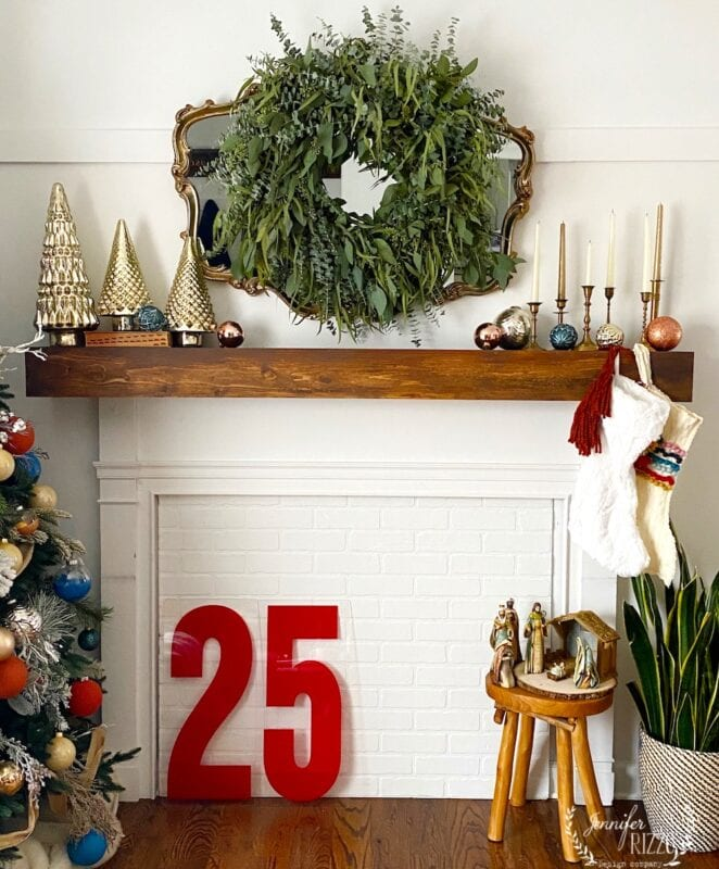 Faux fireplace styled with a fresh eucalyptus wreath