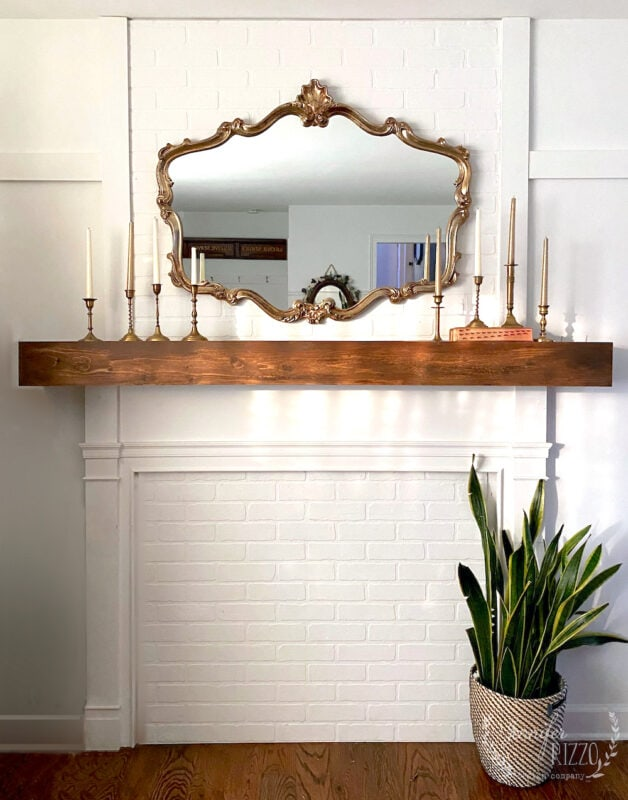 Faux fireplace makeover with faux brick panel