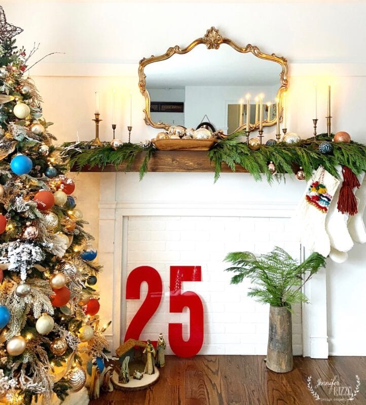 The Home of Jennifer Rizzo Christmas Mantel idea with cedar, vintage candle sticks, and large vintage marquis letters