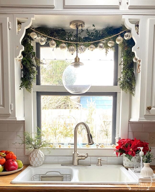 Kitchen window for Christmas with greenery and color