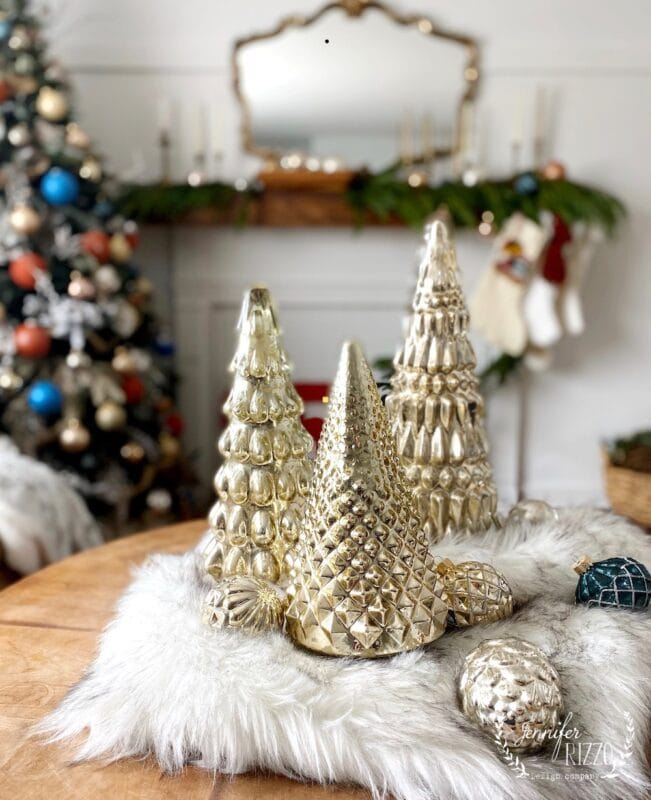 Mercury glass Christmas trees on a faux fur blanket