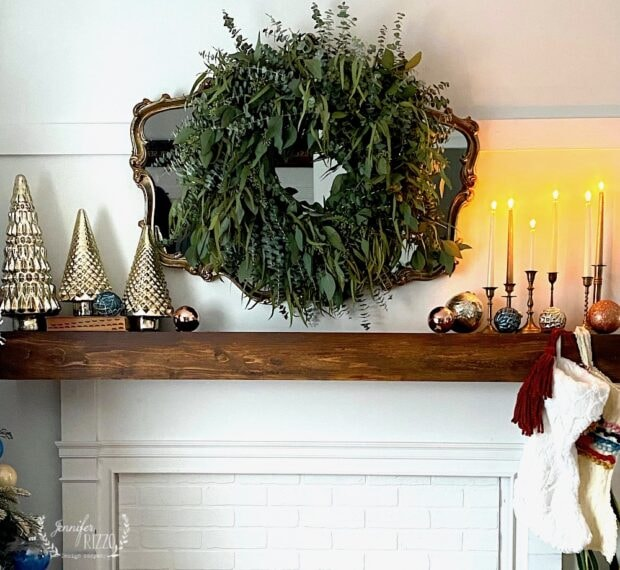 Mantel with eucalyptus wreath and vintage decor