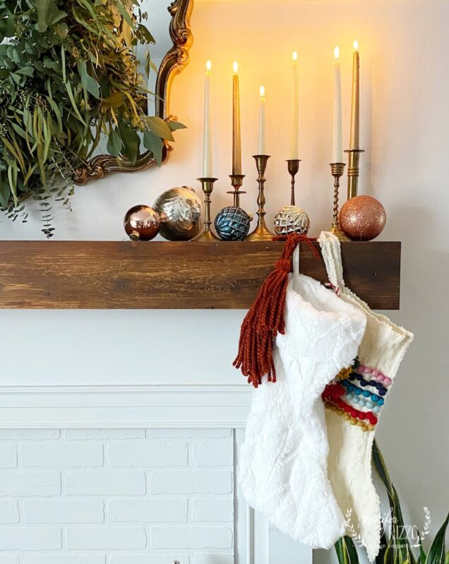 Simple Christmas mantel decor with vintage brass candle sticks and ornaments