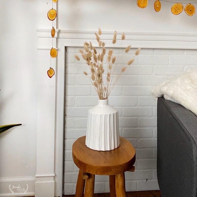 Bunny tail grass in a white ceramic boho vase