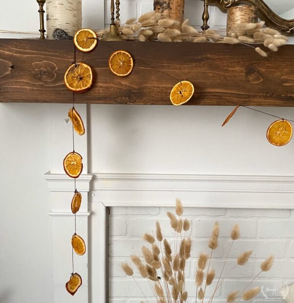 Oven baked orange slices made into a DIY garland