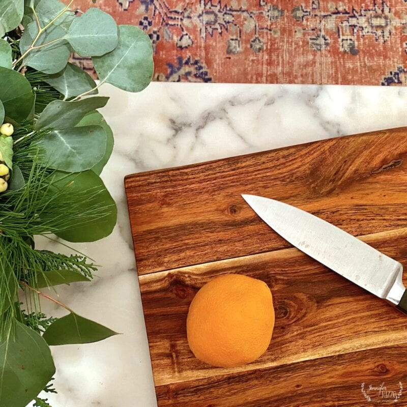 Orange on cutting board and how to dry orange slices in the oven