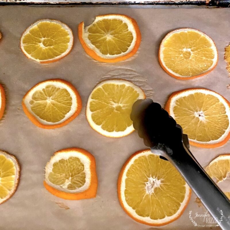 Turn orange slices halfway through while oven drying