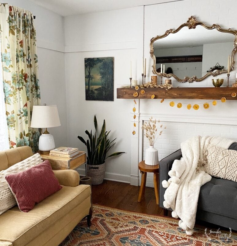 Cozy winter decor living room with plants and brass candlesticks