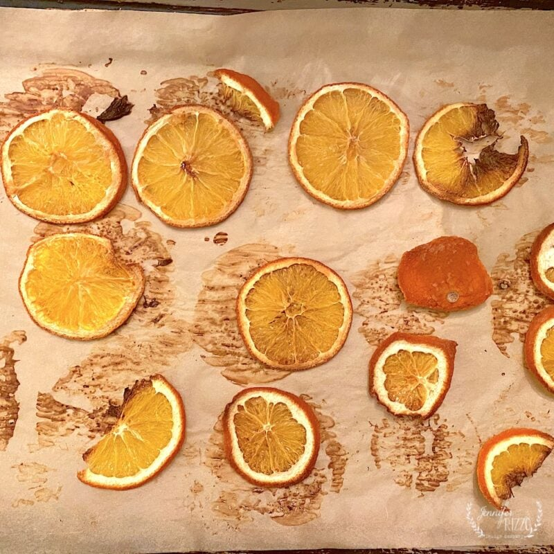 Oven dried orange slices on parchment paper