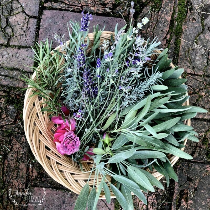 A basket of gathered herbs and flowers for DIY pot pourri and drying