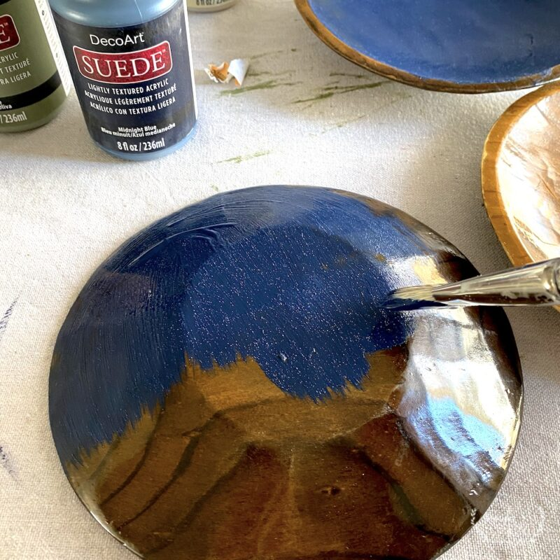 Painting the backside of the wood bowls with sueded matte acrylic lightly textured paint
