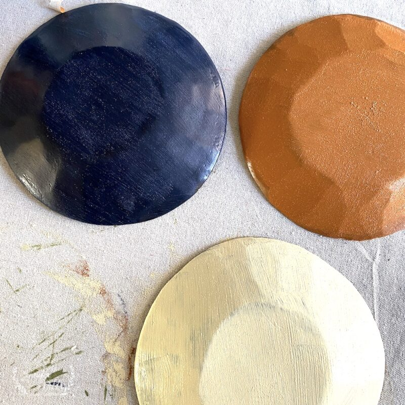 Let painted bowls dry then paint inside with matte acrylic textured paint