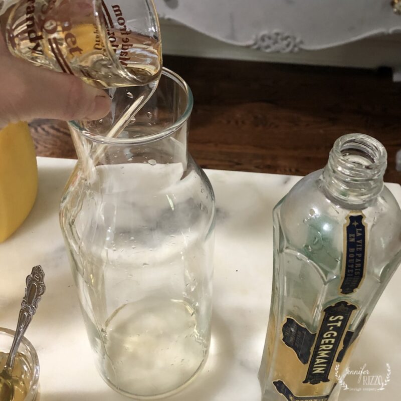 Pour spirits into pitcher for cocktail