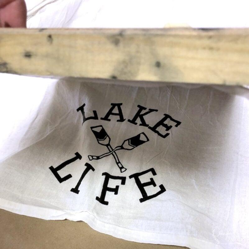 Carefully lift silk screen off of fabric