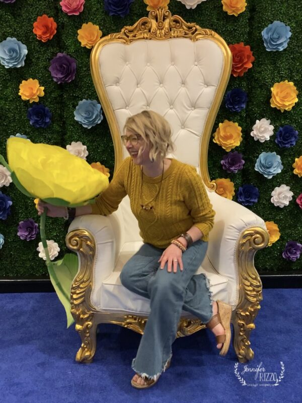Jennifer Rizzo in big flower chair