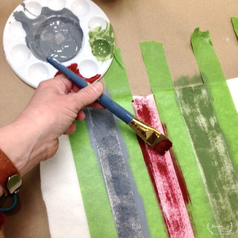 Use a bruch to lightly paint on stripes with fabric paint