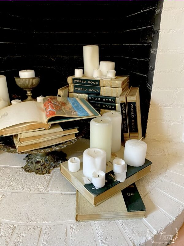 Thick as Thieves vignette in fireplace with vintage books and candles