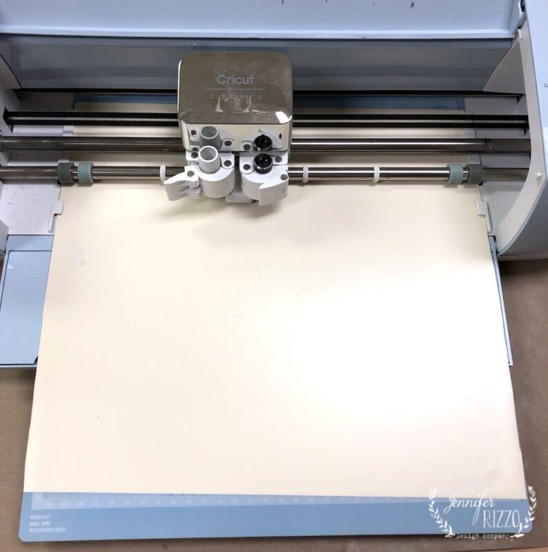 Cut out a stencil with a Cricut to silk screen