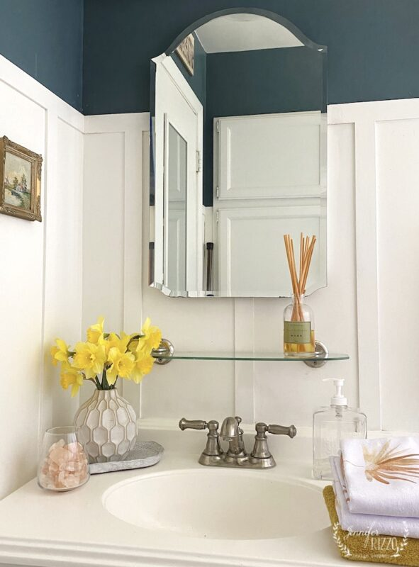 Pretty sink area with board and batten and art