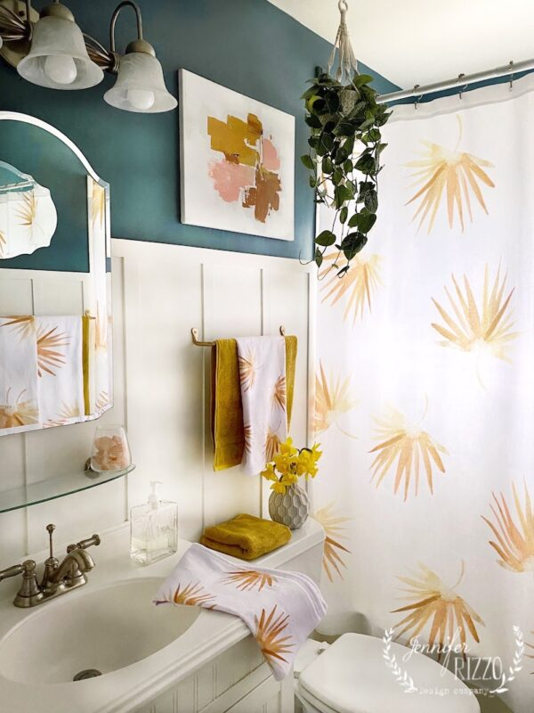 Sunny Golden Fan Palm Bathroom makeover with abstract art, a hanging pothos plant, and Golden Fan Palm Shower curtain by Jennifer Rizzo