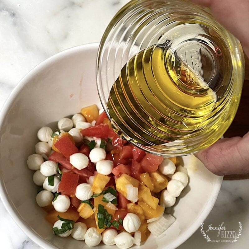 Drizzle olive oil over tomatoes and mozzarella cheese