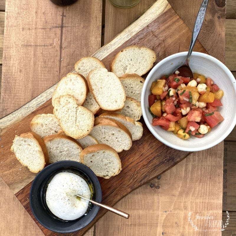 Burrata and quick and easy tomato basil bruschetta on toasted bread