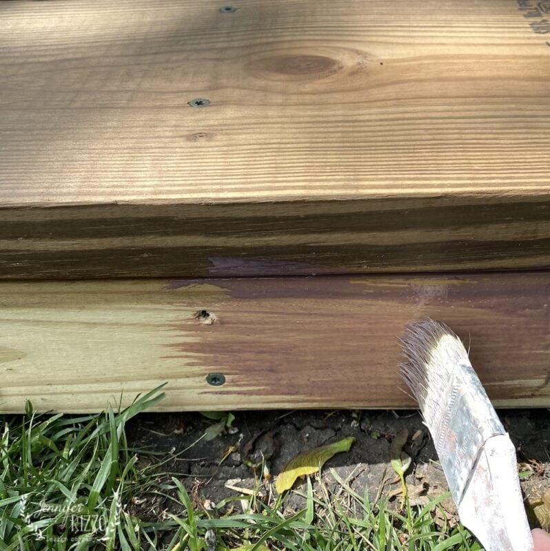 Applying trasnparent sealer to a wood platform deck