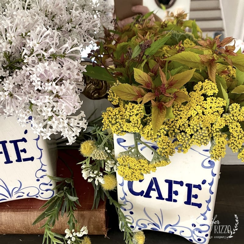 Flower Arrangements in Vintage Blue and White Canisters