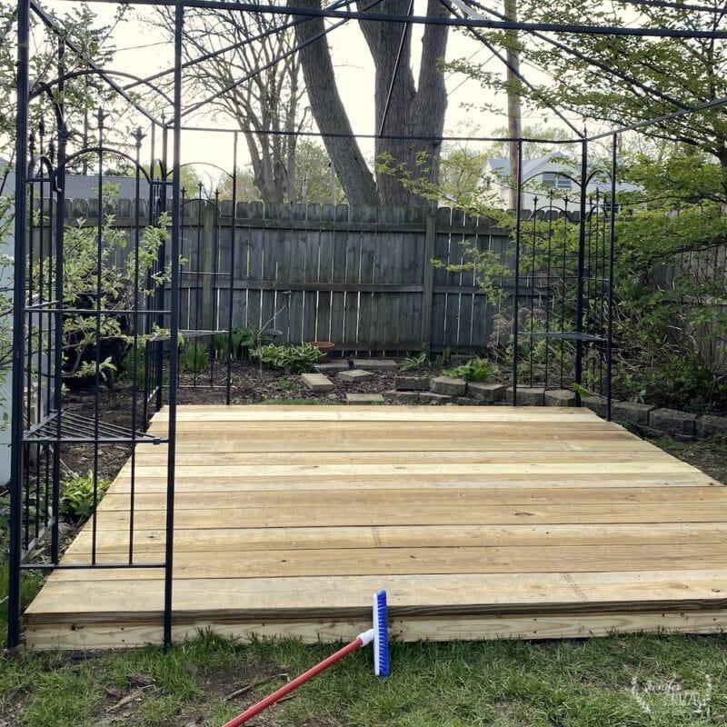 Wood platform deck under metal gazebo