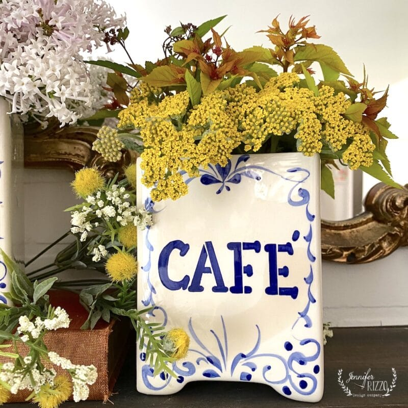 Yarrow and spirea in vintage french coffee canister