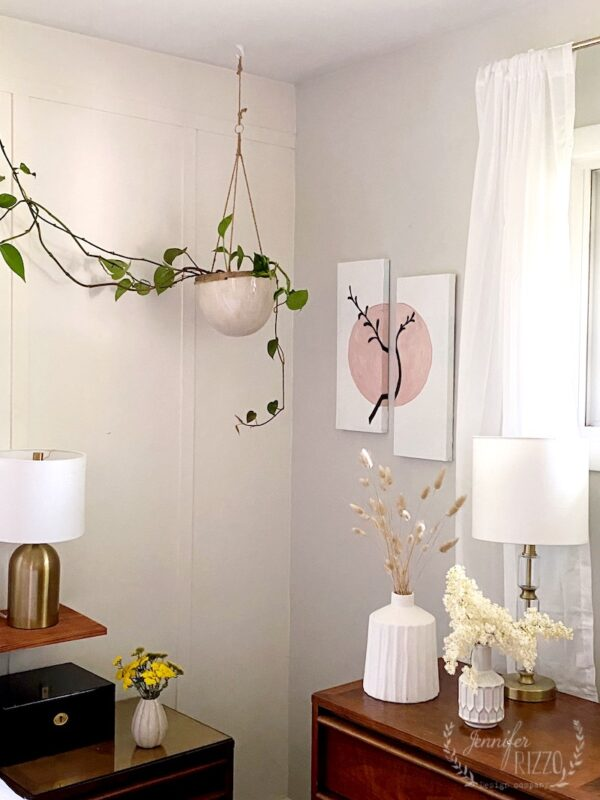 Modern DIY abstract paneled art and white vases with grasses